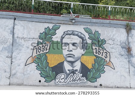 "Varna, Bulgaria - May 14, 2015: graffiti painted by Non-Governmental Organization ""Vuzrojdenci Varna"" on the wall on the road of Asparuhovo bridge. - stock photo"