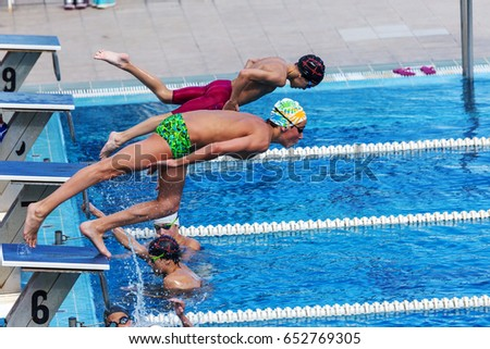 Olympic Swimming Pool 2017 little boy jumping into swimming pool stock photo 409492051