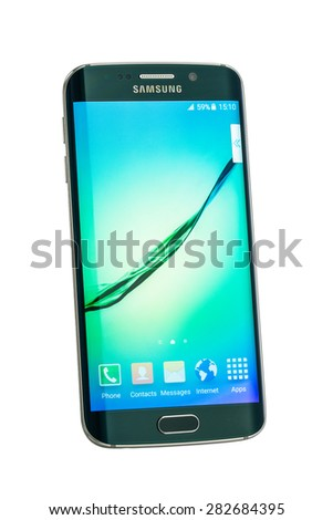 Varna, Bulgaria - May, 26, 2015: Studio shot of a green Samsung Galaxy S6 Edge smartphone, with 16 mP Camera, quad-core 2,7 GHz and 440 x 2560 pixels Display Resolution with clipping path