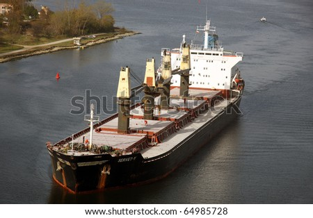 VARNA, BULGARIA - NOVEMBER 11: Cargo ship SERVET-Y (Flag: Turkey) sails  into open sea after being loaded with 30 000 tonnes of triple superphosphate on November 11, 2010 in Varna, Bulgaria. - stock photo