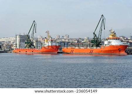 Varna, BULGARIA - November 29, 2014: Two supply ships NORMAND CORONA and NORMAND CARRIER at Port of Varna-East. The vessels will take part in the construction of gas pipeline from Russia to Europe. - stock photo