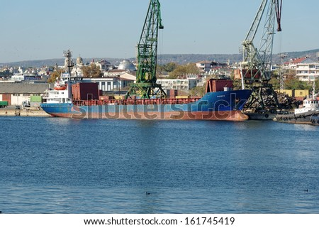 VARNA, BULGARIA - OCT 27: Cargo ship Blue Sky S (IMO: 7601073, Year Built: 1977, Flag: Moldova) is loaded with 2000 t of scrap metal in Port of Varna-East on October 27, 2013 in Varna, Bulgaria. - stock photo
