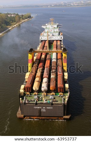 VARNA, BULGARIA - SEPTEMBER 19: Bulgarian cargo ship GEROITE NA ODESSA (Year Built: 1978, DeadWeight: 12900 t) sails to a special ferry terminal on September 19, 2010 in Varna, Bulgaria. - stock photo