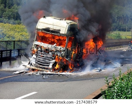 VARNA, ITALY - SEPTEMBER 10, 2014: Fire and black smoke on the road after a truck collision in Varna on 10 September 2014