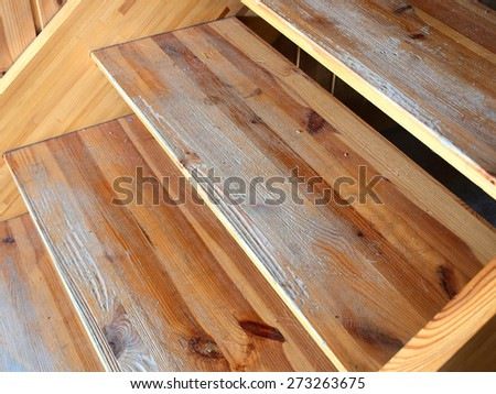 Varnished wooden stairs with shabby steps after long time use        - stock photo