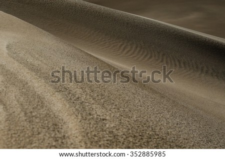 Varying textures along a ridge of the sand dune - stock photo