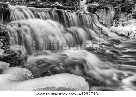 Vasaristi cascade by early spring in Lahemaa national park, Estonia. Long exposure, monochrome image - stock photo