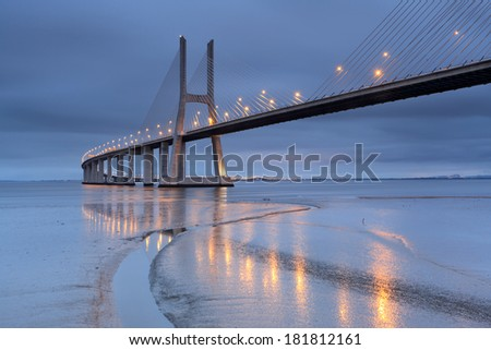 Vasco da Gama Bridge at sunrise even with the lights on