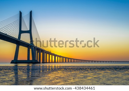 Vasco da Gama Bridge at sunrise, Lisbon, Portugal - stock photo