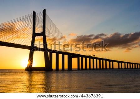 Vasco da Gama Bridge at sunrise, Lisbon, Portugal, Europe. - stock photo