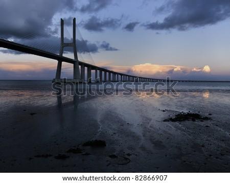 Vasco da Gama bridge at sunset - stock photo