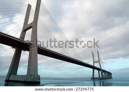 Vasco da Gama bridge at sunset in Lisbon - stock photo