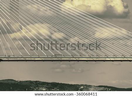 Vasco da Gama bridge, crossing the Tagus river - Lisbon, Portugal (stylized retro) - stock photo