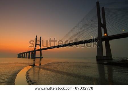 Vasco da Gama bridge in Lisbon Portugal at dawn - stock photo
