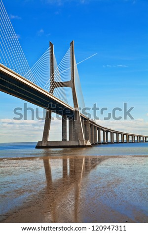 Vasco da Gama bridge in Lisbon, Portugal. On Blue Sky - stock photo