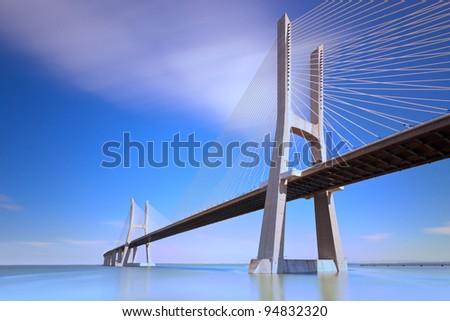 Vasco da Gama bridge on Tagus River, Lisbon, Portugal. - stock photo