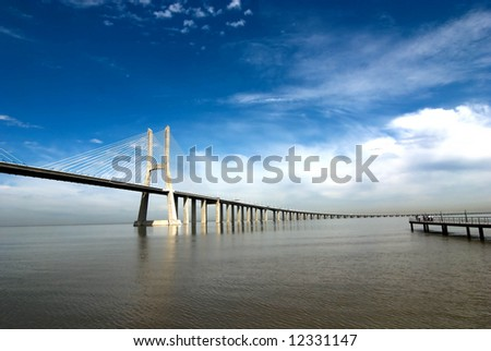 Vasco da Gama Bridge over the tagus river is the largest bridge in all Europe - stock photo