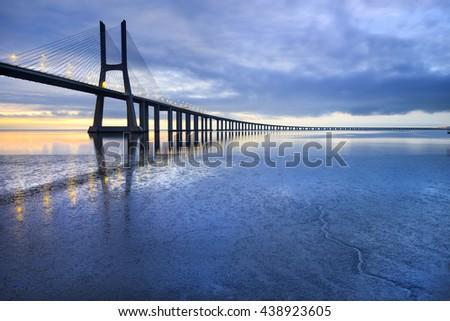 Vasco da Gama bridge. The longest bridge in Europe and a sight attraction of Lisbon, Portugal. - stock photo