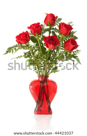 vase arrangement of 6 long stem red roses in a heart shaped red glass vase isolated on white - stock photo