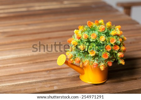 Vase flower pot. Placed on a table made of wood inside the house. - stock photo