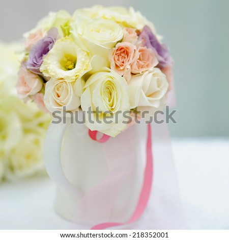 Vase full of roses as decoration on the table
