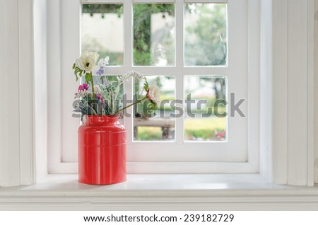 vase of flower with window frame at home