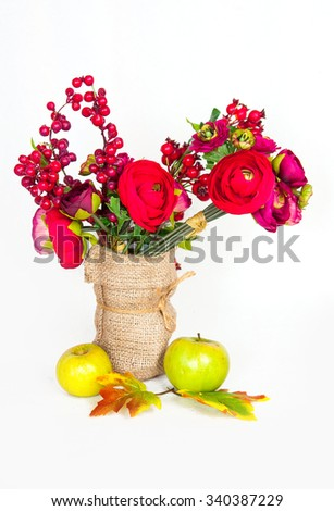 vase of roses,apples and wild rose on a white background