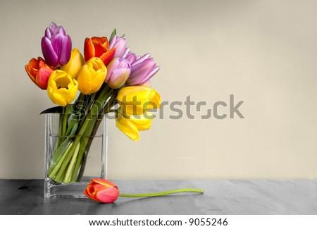 vase of tulips on table - stock photo