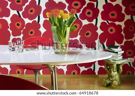 vase of tulips on the table - stock photo