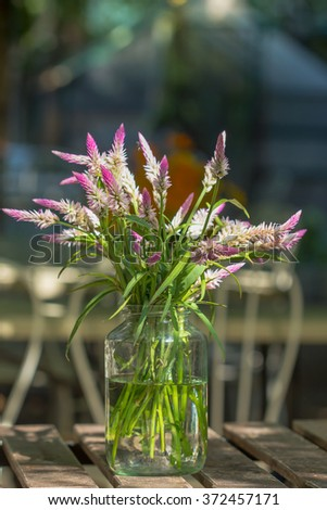 vase of various types of flowers in Vintage Style outdoor Living - as part of the home decoration