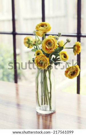 Vase of yellow roses flowers with window background - stock photo