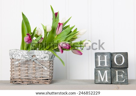 Vase white tulips at home in interior - stock photo