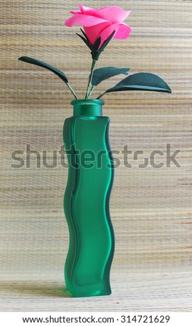 Vase with artificial flower - stock photo