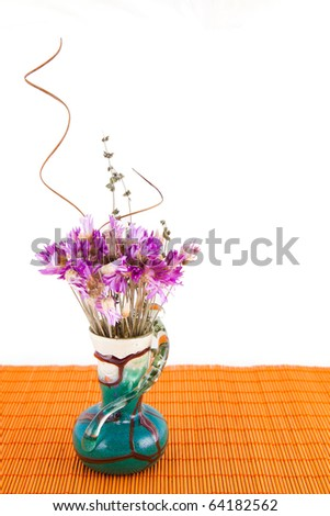 Vase with dry flowers isolated on white background.