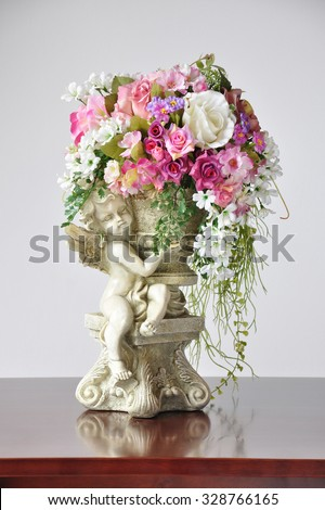 Vases artificial flowers, Lovely Angel Cupid Flower Vase Ornament - stock photo