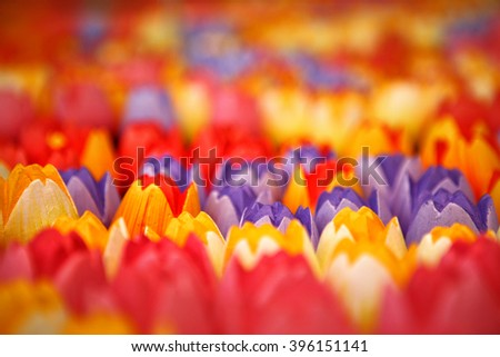 Vases full of bright colorful wooden tulips for sale at flower market in Amsterdam, The Netherlands - stock photo