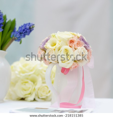 Vases full of flowers as decoration on the table