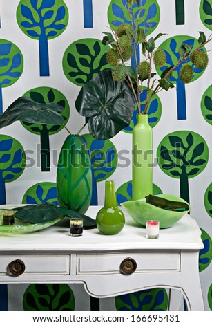 Vases on a chest of drawers - stock photo