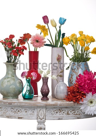 Vases with flowers on a console - stock photo