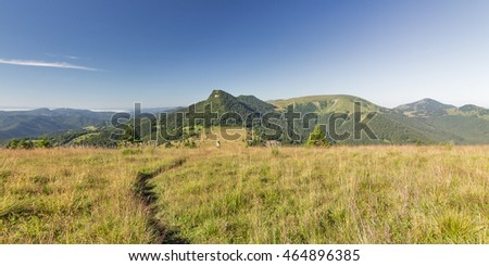 vast grassy meadow along mountain ridge in Velka Fatra mountains in Slovakia - panoramic view