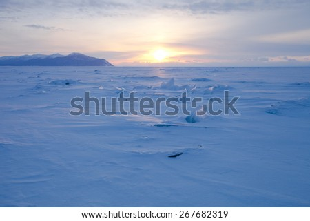 Vast snowy wilderness. Lake Baikal in winter. - stock photo