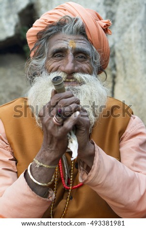 Vastanji, India - January 07, 2014: holy man at Muni maharaj Temple in vastanji village, Sadhu devoted his whole life in meditation after wear Saffron religion apparel in india