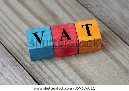 VAT text (Value Added Tax) on colorful wooden cubes - stock photo