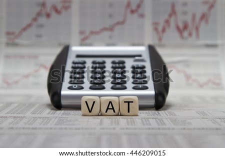 VAT word on a business newspaper background - stock photo