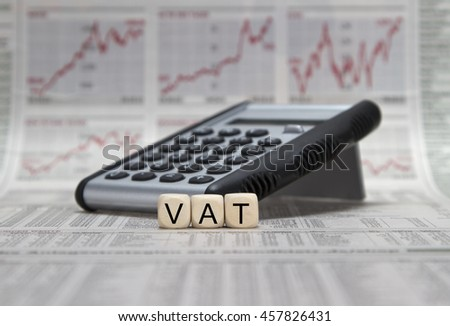 VAT word on a business newspaper background