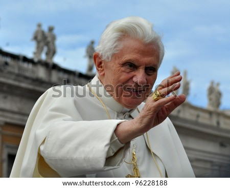 VATICAN - APRIL 6: Pope Benedict XVI blesses people at Saint Peter's square April 6, 2011 in Vatican. Pope Benedict XVI was elected on April 19, 2005 in a papal conclave. - stock photo