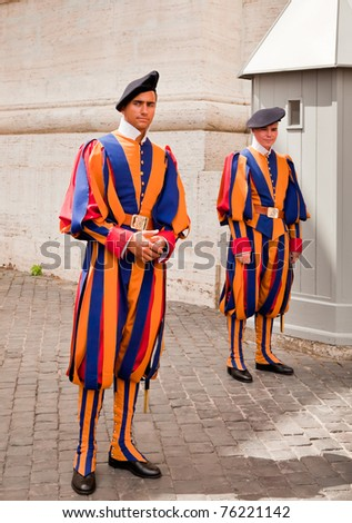VATICAN CITY, ITALY - AUGUST 20: Two Swiss Guards dressed in uniforms designed by Leonardo da Vinci in the Vatican City, Italy, 20 August, 2010. - stock photo