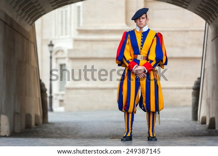 VATICAN CITY, ITALY - DECEMBER 01, 2014: A member of the Pontifical Swiss Guard, Vatican. - stock photo