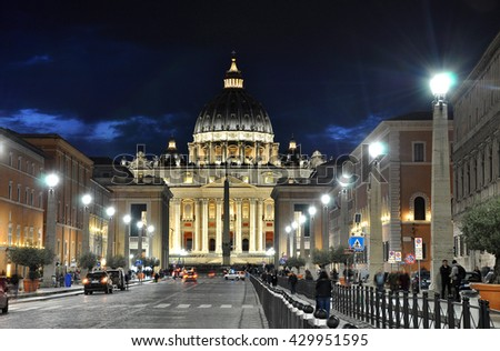 VATICAN CITY, ITALY - MARCH 17, 2016: Tourists visiting the Saint Peter square at night. This part of the Vatican city is opened all the night - stock photo