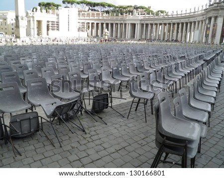 VATICAN CITY, MARCH 1ST: No Pope, no audience. Audience perspective with empty plastic seats in St. Peter's Square, Vatican City (Rome), on March 1st, 2013. - stock photo